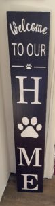 Welcome sign paw print